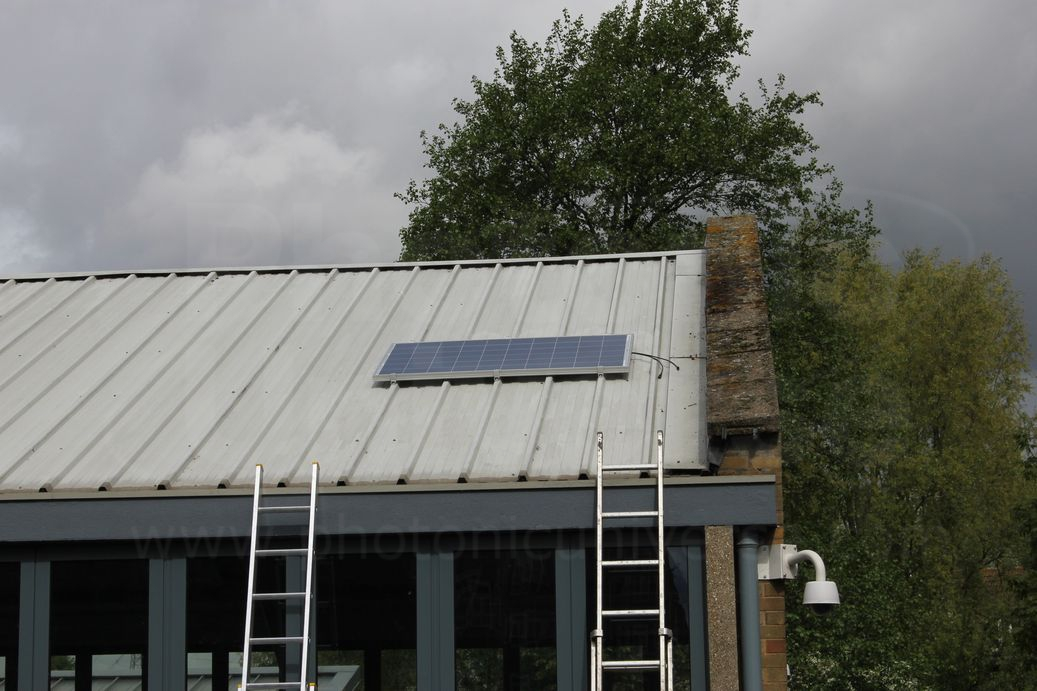 Installation of a 250W solar panel on commercial building